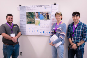 Joey Moore, Brittany Lokcu and Sam Poster stand with their poster on zebra mussel research at the...