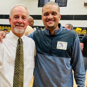 Clifton Ellis stands with former men's basketball coach Kirby Johnson at Johnson's last game in February 2020. Ellis played under Johnson from 1995-1997 and has been named to succeed him.