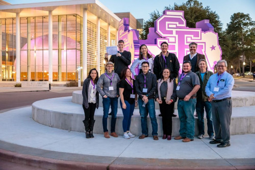 Students and faculty members who attended the 2020 Texas Academy of Science meeting pose for a gr...